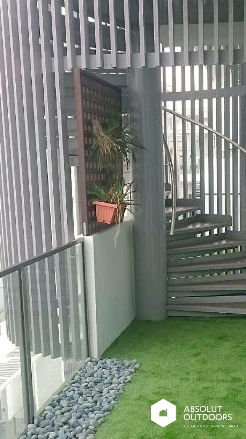 Wooden Screen under Circular Stairwell